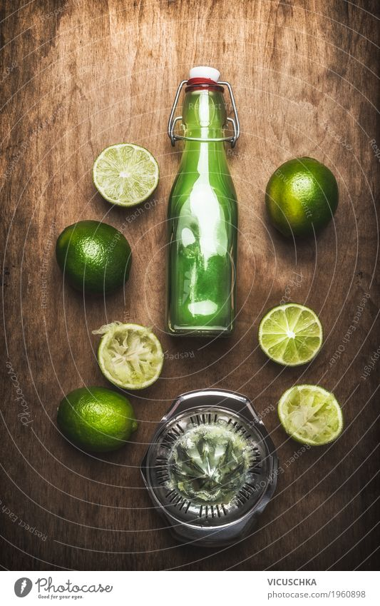 Lime juice in bottle with fruits and juicer Food Fruit Nutrition Organic produce Vegetarian diet Diet Beverage Juice Crockery Bottle Style Design Healthy Eating