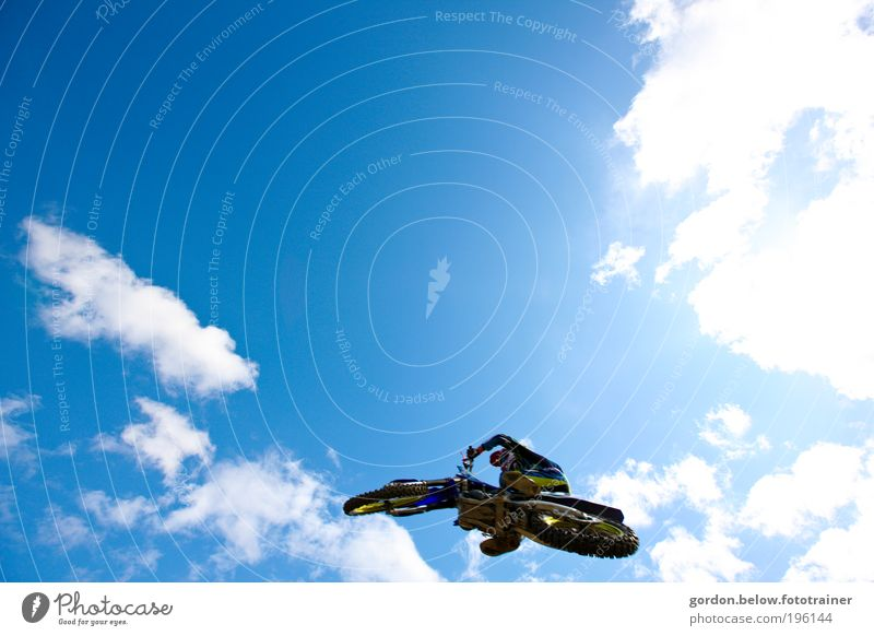close to heaven Lifestyle Motocross racing Sports Motorsports Sporting event Motorcycle Flying Jump Blue Brave Risk Colour photo Exterior shot Copy Space top