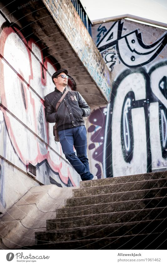 Human being Youth (Young adults) Man Blue Town Young man Relaxation 18 - 30 years Adults Graffiti Style Gray Masculine Dirty Stand Wait