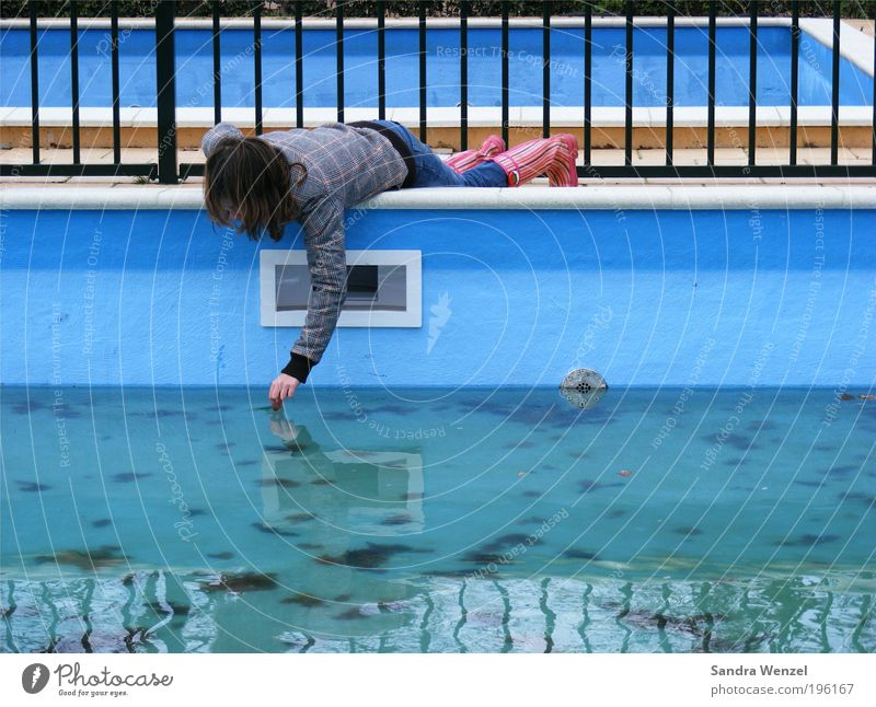 Human being Child Blue Water Girl Leaf Playing Metal Infancy Wet Concrete Swimming pool Jeans Touch Jacket Discover