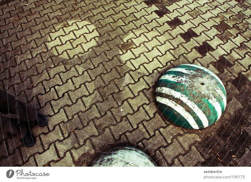 Photo with stones, but without title Stone Paving stone Cobblestones Sidewalk Lanes & trails Seam Profile profile stones Bollard Stripe Shadow Wet Dry Feet Legs