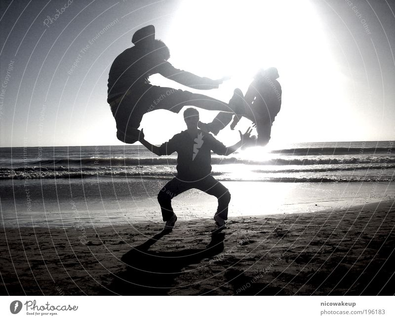 Martial arts Human being Masculine Young man Youth (Young adults) 18 - 30 years Adults Sunlight Waves Coast Beach Sand Water To enjoy Jump Cool (slang) Funny