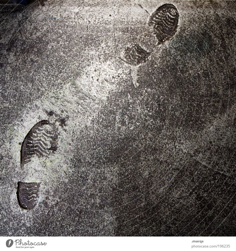 Street Gray Lanes & trails Feet Going Walking Trip Concrete Gloomy Uniqueness Construction site Tracks Sign Footprint Whimsical Mobility
