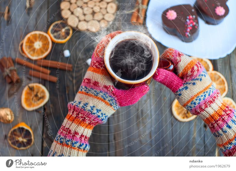 cup of black coffee in his hands over the table Human being Youth (Young adults) Old Young woman Hand 18 - 30 years Adults Eating Wood Gray Brown Above Orange