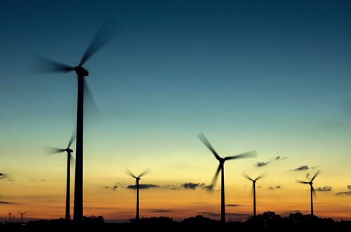 Wind turbines at sunset Machinery Technology Science & Research Advancement Future High-tech Energy industry Renewable energy Wind energy plant Industry