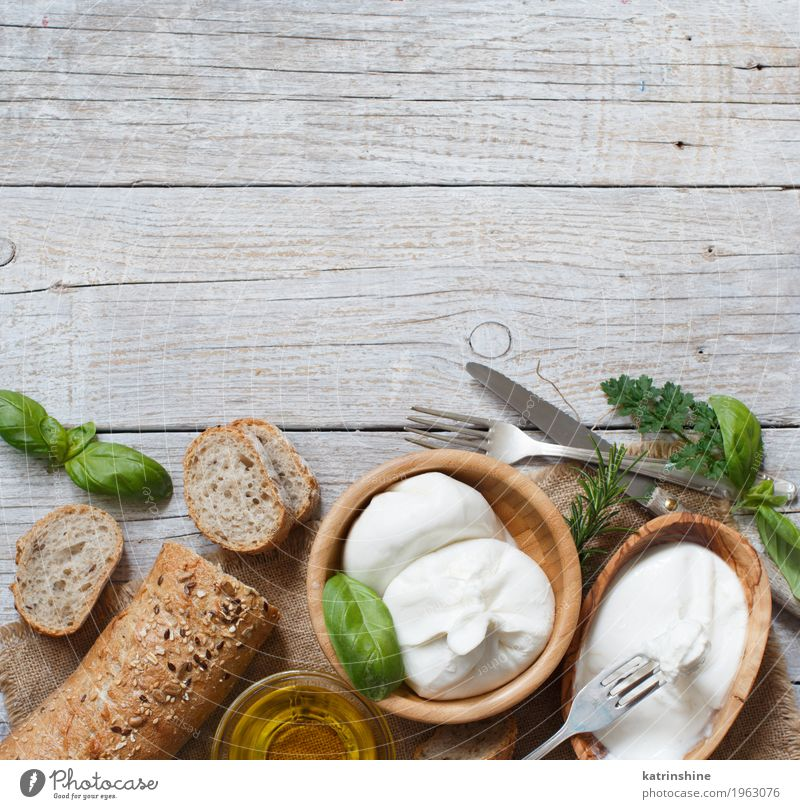 Italian cheese burrata, olive oil and bread Cheese Bread Herbs and spices Nutrition Vegetarian diet Italian Food Bowl Fork Fresh Delicious Soft Green White