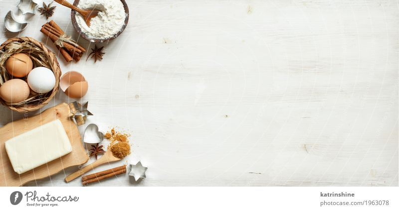 Ingredients and utensils for baking Dairy Products Dough Baked goods Dessert Herbs and spices Bowl Table Kitchen Wood Fresh Brown White background Baking Bakery