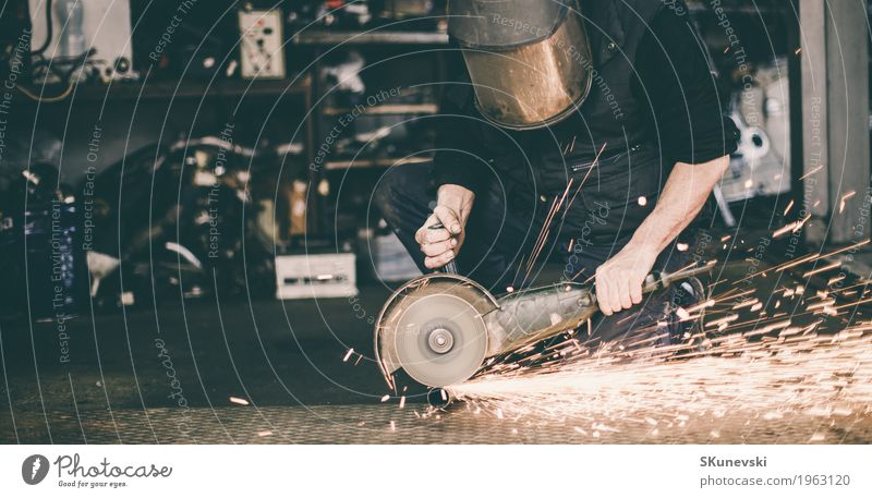 Metal grinding on steel spare part in workshop. Death Work and employment Technology Speed Industry Construction site Protection Safety Smoke Factory Steel Tool