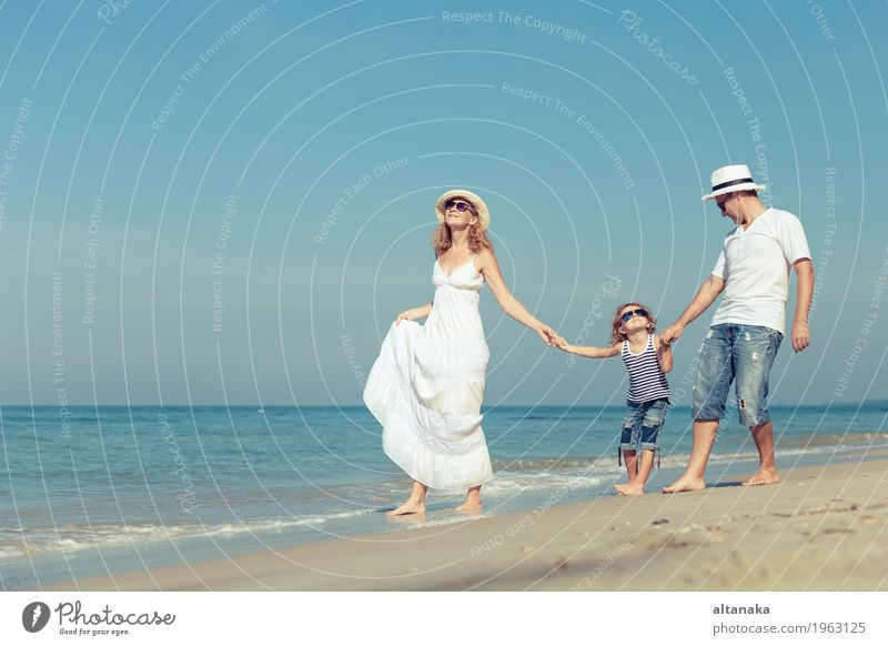 Happy family walking on the beach at the day time. Child Woman Nature Vacation & Travel Summer Sun Ocean Relaxation Joy Beach Adults Life Love Lifestyle Sports