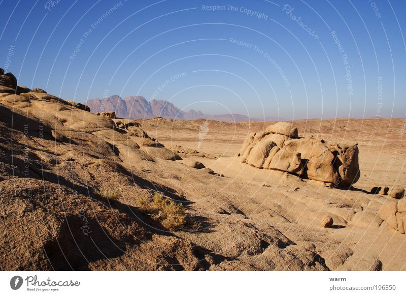 Nature Sky Sun Blue Calm Far-off places Mountain Freedom Gray Landscape Brown Environment Rock Earth Desert Beautiful weather