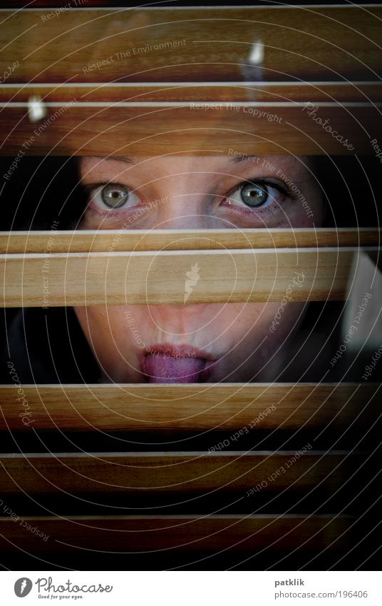 Ällebätsch Feminine Young woman Youth (Young adults) Face Eyes 1 Human being 18 - 30 years Adults Observe Tongue Roller blind Reflection Hide Mysterious Looking