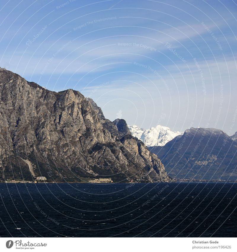 Nature Water Sky Blue Vacation & Travel Mountain Stone Lake Coast Horizon Vantage point Italy Lakeside Sky blue Lake Garda