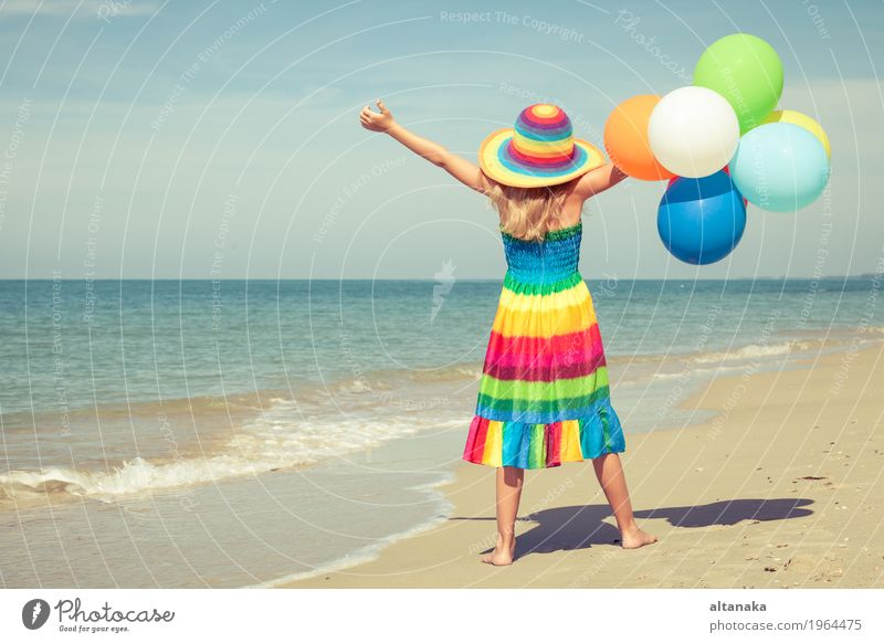 Little girl with balloons standing on the beach Human being Child Woman Nature Vacation & Travel Summer Sun Hand Ocean Relaxation Joy Girl Beach Adults