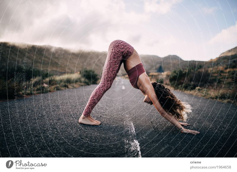 Young female adult practicing yoga on scenic road Woman Nature Youth (Young adults) Young woman Landscape Mountain Adults Street Life Lifestyle Sports Healthy