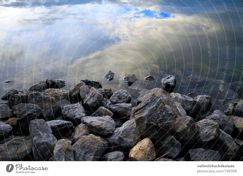 Sky Nature Water Clouds Environment Landscape Lake Air Rock Pond Light