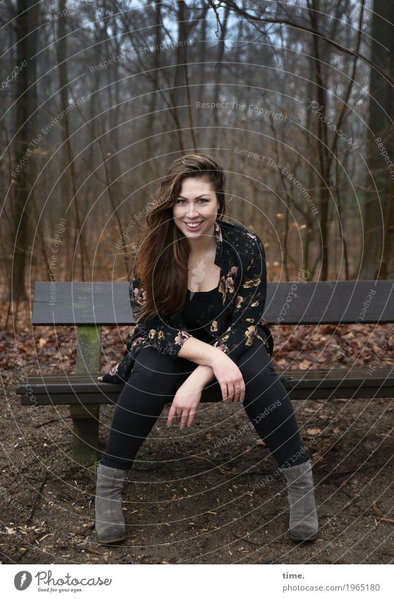 Anne Feminine Woman Adults 1 Human being Forest Pants Jacket Boots Brunette Long-haired Bench Observe Smiling Laughter Looking Sit Wait Friendliness Happiness