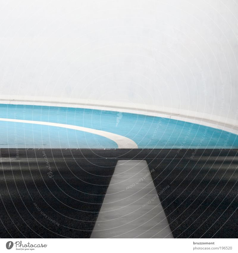 White Blue Black Street Wall (building) Line Road traffic Signs and labeling Transport Logistics Tunnel Curve Motoring Left Parking garage Highway ramp (exit)