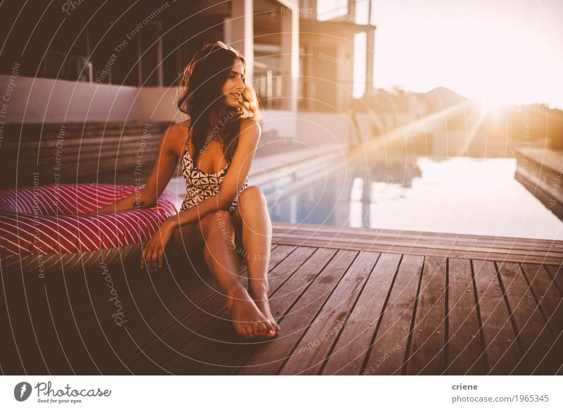 Young caucasian women relaxing at swimming pool in sunset Human being Woman Vacation & Travel Youth (Young adults) Summer Young woman Beautiful Sun Relaxation