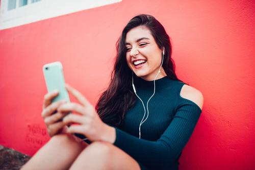 Happy caucasian women listening to music on smart phone Human being Youth (Young adults) Young woman Joy 18 - 30 years Adults Lifestyle Feminine Laughter Music