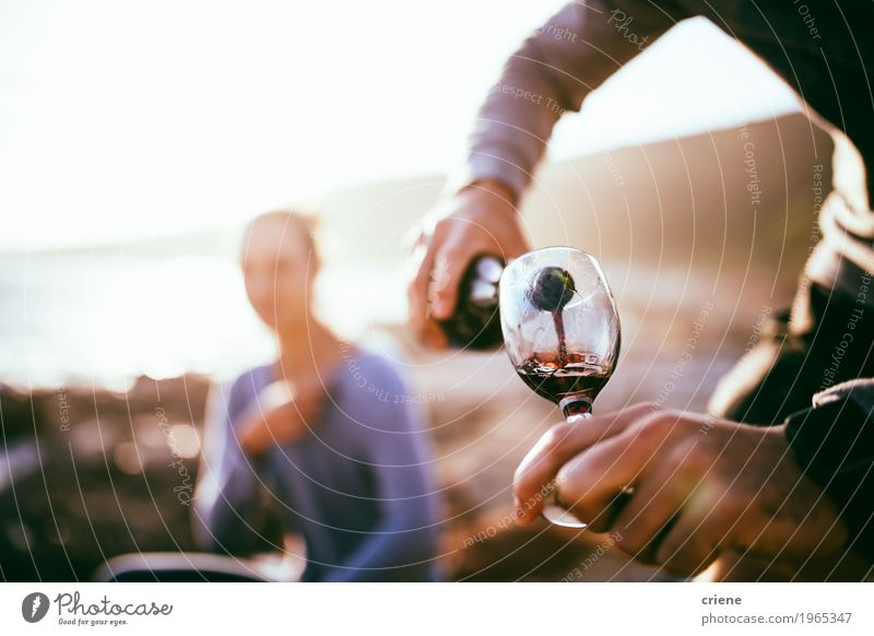 Man filling glass with wine on date at beach in sunset Human being Woman Youth (Young adults) Man Summer Joy Beach Adults Lifestyle Coast Happy Together Glass Beverage Wine Bottle