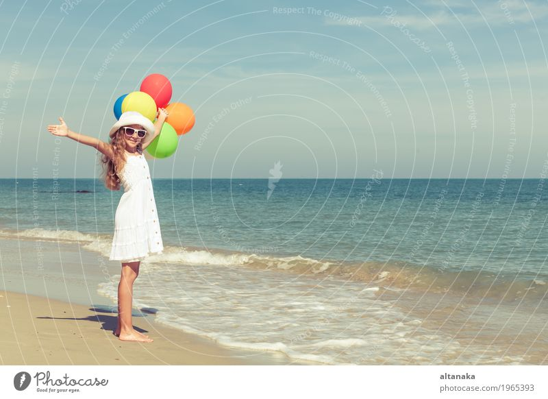Teen girl with balloons standing on the beach Human being Child Woman Nature Vacation & Travel Summer Sun Hand Ocean Relaxation Joy Girl Beach Adults Lifestyle