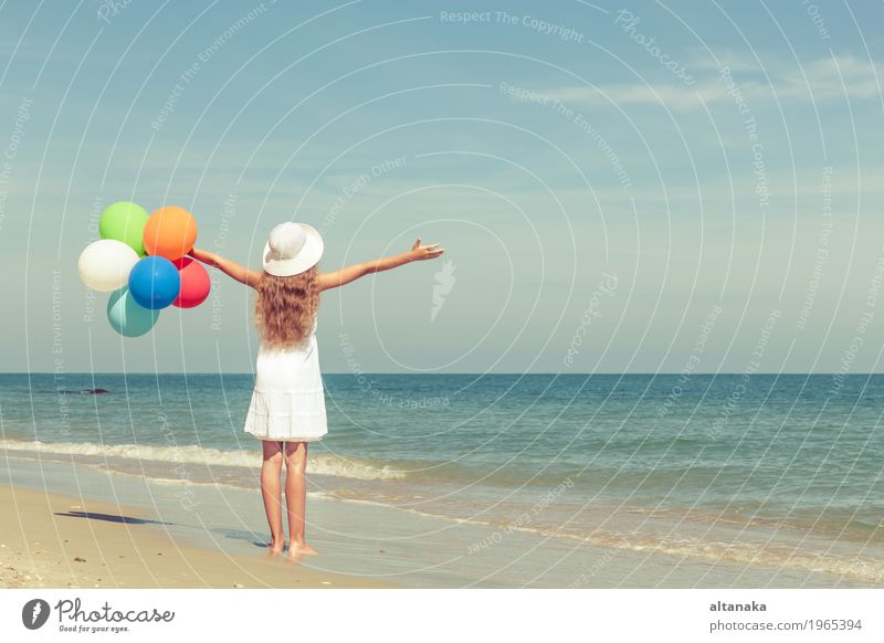 Teen girl with balloons standing on the beach Lifestyle Joy Happy Relaxation Leisure and hobbies Playing Vacation & Travel Trip Adventure Freedom Summer Sun