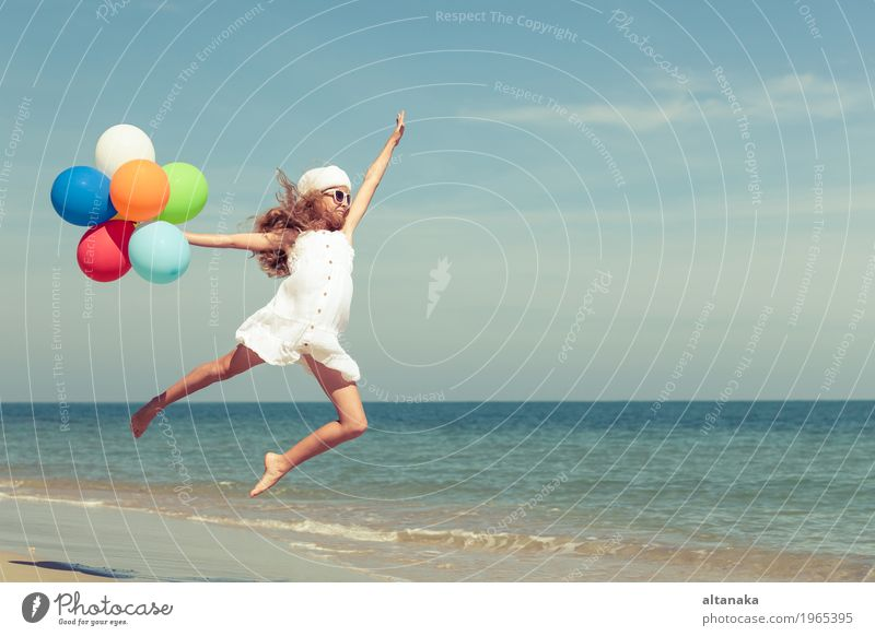 Teen girl with balloons jumping on the beach Lifestyle Joy Happy Relaxation Leisure and hobbies Playing Vacation & Travel Trip Adventure Freedom Summer Sun