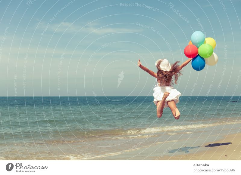 Teen girl with balloons jumping on the beach Human being Child Woman Nature Vacation & Travel Summer Sun Hand Ocean Relaxation Joy Girl Beach Adults Lifestyle