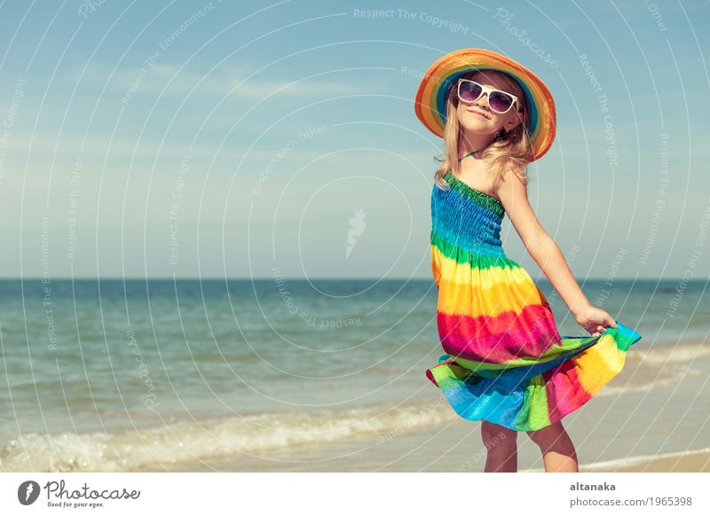 Little girl standing on the beach Lifestyle Joy Happy Relaxation Leisure and hobbies Playing Vacation & Travel Trip Adventure Freedom Summer Sun Beach Ocean