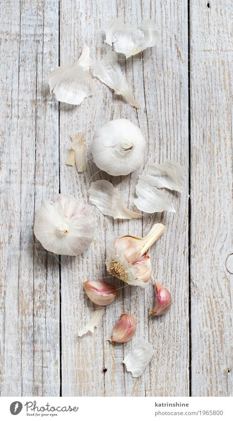 Organic garlic on the old wooden table top view Vegetable Herbs and spices Vegetarian diet Table Old Fresh Gray White Decline bulb Clove food Garlic healthy