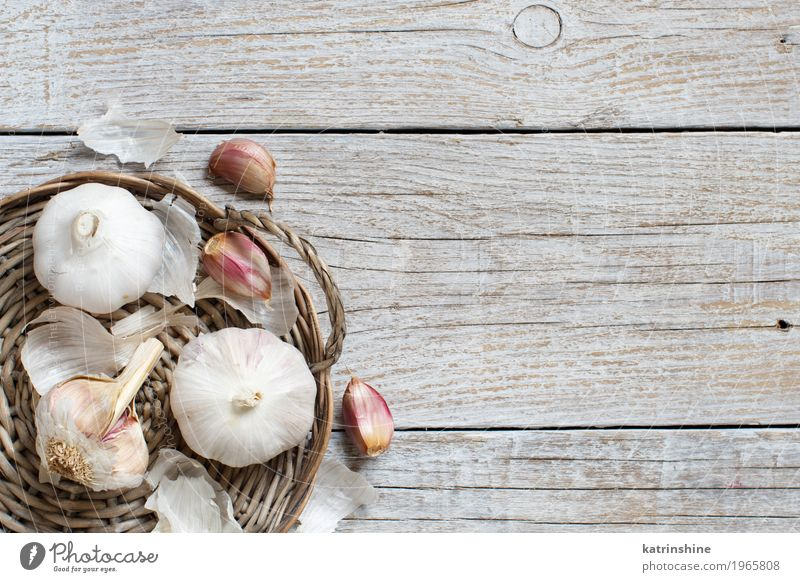 Organic garlic on the old wooden table top view Old White Gray Fresh Table Herbs and spices Vegetable Decline Meal Vegetarian diet Raw Onion Garlic Clove