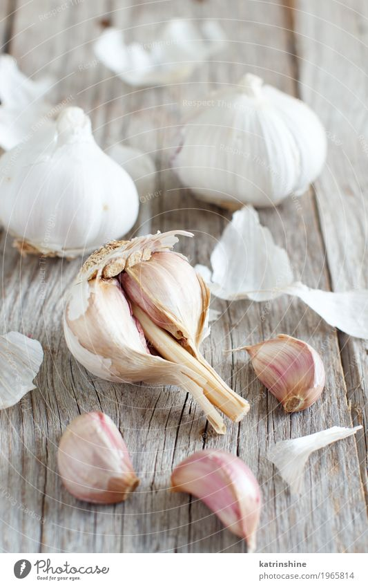 Organic garlic on the old wooden table close up Old White Gray Fresh Table Herbs and spices Vegetable Decline Meal Vegetarian diet Raw Onion Garlic Clove