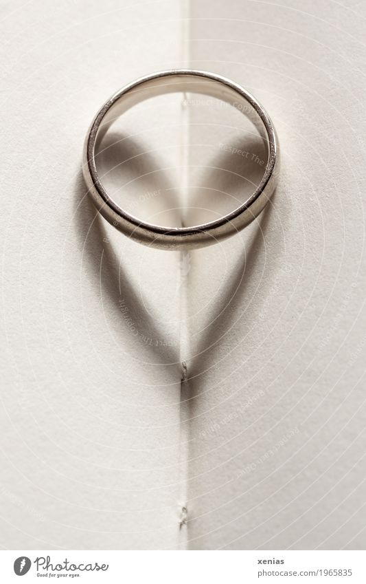 Ring with heart as shadow lies on paper Book Wedding band Jewellery Heart Paper Page Gold Silver White Love Attachment Gold alloy Heart-shaped Matrimony Card