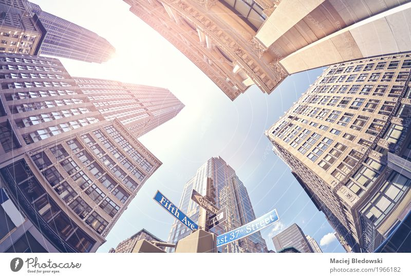 Vintage stylized fisheye lens photo of skyscrapers in Manhattan. Summer Sun Street Building Business Work and employment Office Modern High-rise Retro