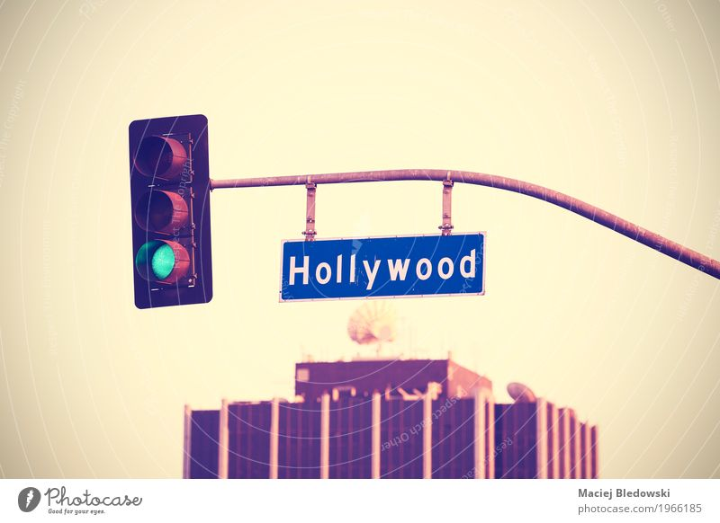 Vintage toned Hollywood street sign and traffic lights. Summer Manmade structures Roof Satellite dish Street Traffic light Road sign Hip & trendy Rich Retro