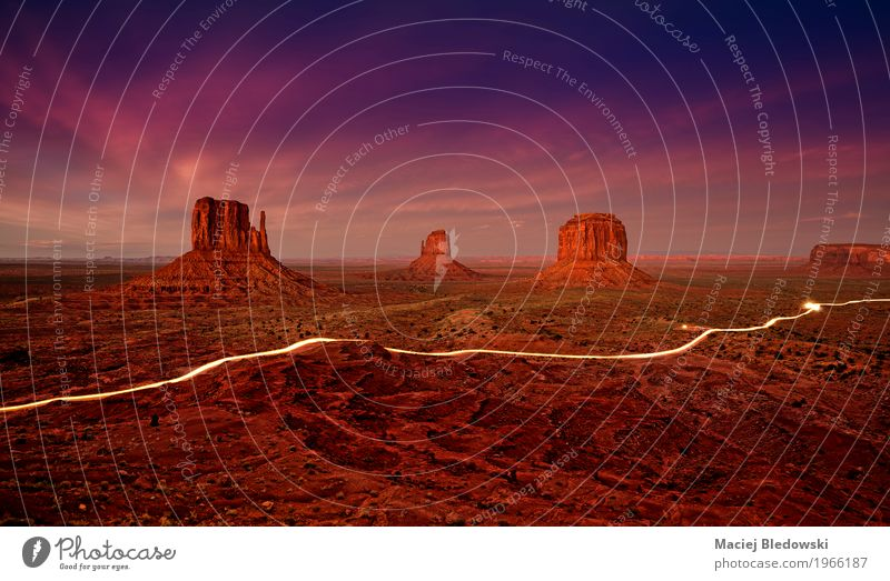 Car lights trails in Monument Valley at night, USA Vacation & Travel Tourism Adventure Mountain Landscape Summer Rock Desert Lanes & trails Dark Wild Violet