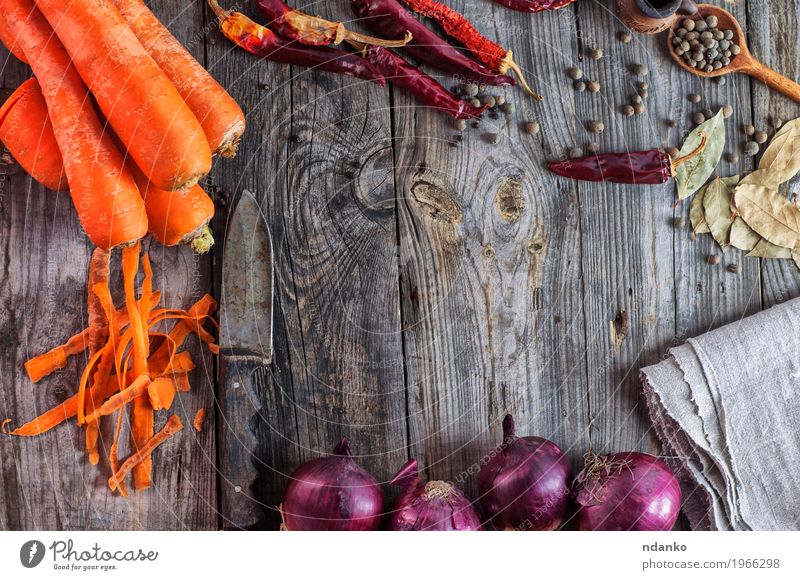 Fresh vegetables carrots and onions on a wooden surface Plant Red Eating Wood Health care Gray Brown Above Orange Fruit Nutrition Fresh Table Herbs and spices Kitchen Vegetable