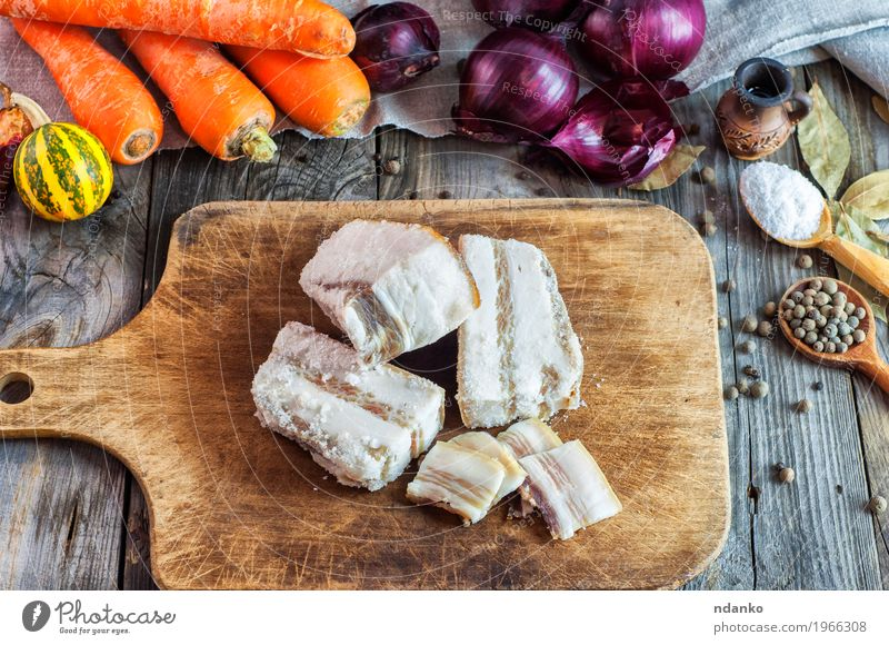 Fresh salted pork fat on a kitchen board Old Red Eating Natural Food Gray Brown Orange Table Herbs and spices Delicious Vegetable Top Slice Vitamin