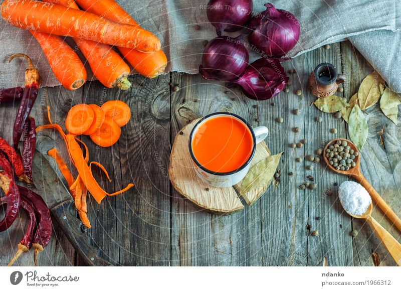 Fresh juice in the iron mug Nature Red Eating Natural Wood Food Health care Gray Above Orange Nutrition Fresh Table Herbs and spices Beverage Vegetable