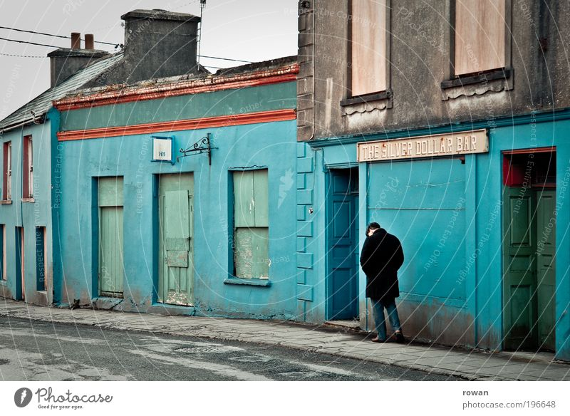 Human being Man Old City House (Residential Structure) Loneliness Dark Wall (building) Sadness Wall (barrier) Building Adults Going Masculine Facade Retro