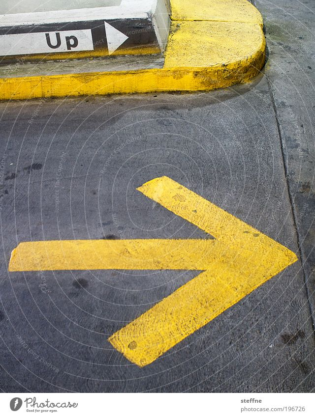 Yellow Above USA Asphalt Arrow Signage Testing & Control Transport Parking garage Symbols and metaphors Signs and labeling