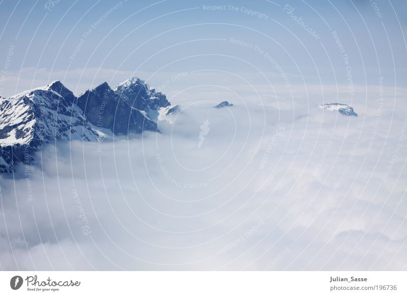 above the clouds Environment Nature Landscape Air Earth Sky Clouds Horizon Sun Sunlight Winter Engelberg Titlis Above the clouds Mountain Calm Relaxation