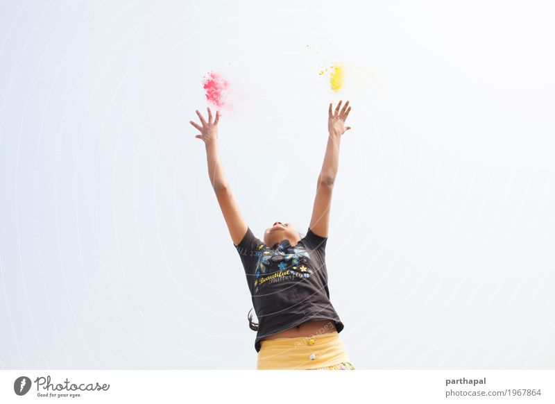 A girl stretching arms and throwing Color powder Lifestyle Girl Arm Hand 1 Human being 8 - 13 years Child Infancy Fitness Jump Happiness Enthusiasm Power Energy