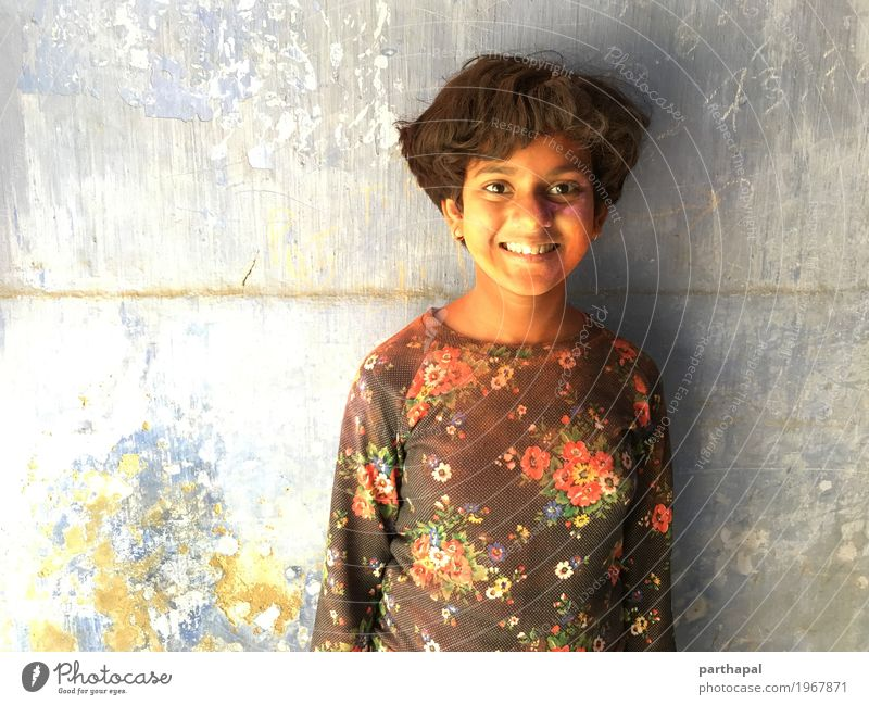 Girl smiling and face smudged with color powder Child Beautiful Joy Infancy Happiness 8 - 13 years