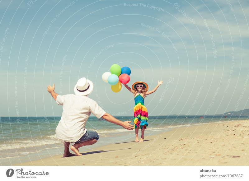 Father and daughter with balloons playing on the beach Child Woman Nature Vacation & Travel Summer Sun Hand Ocean Relaxation Joy Girl Beach Adults Life