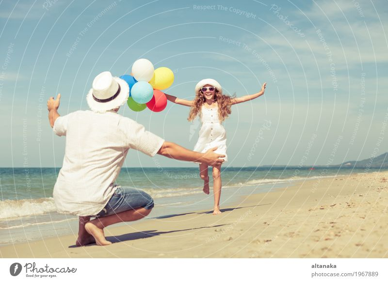Father and daughter with balloons playing on the beach Child Woman Nature Vacation & Travel Summer Sun Hand Ocean Relaxation Joy Girl Beach Adults Life Lifestyle Love