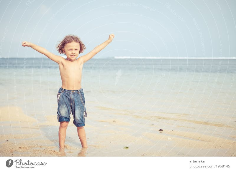 Portrait of little boy standing on the beach Lifestyle Joy Happy Relaxation Leisure and hobbies Playing Vacation & Travel Trip Adventure Freedom Summer Sun