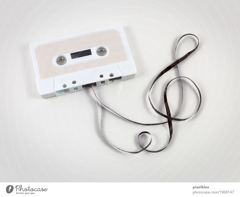 Cassette with clef Entertainment Party Music Entertainment electronics Culture Youth culture Listen to music Tape cassette Listening Old Retro White Analog
