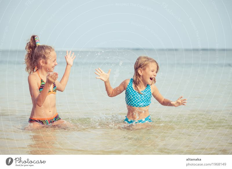 Two happy children playing on the beach Human being Child Nature Vacation & Travel Summer Beautiful Sun Hand Ocean Relaxation Joy Girl Beach Lifestyle Emotions