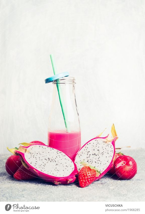 Pink smoothie in bottle with tropical fruits Fruit Organic produce Vegetarian diet Diet Beverage Juice Crockery Bottle Style Design Healthy Healthy Eating